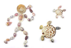 Seashells in the shape of human with two turtles Stock Photography