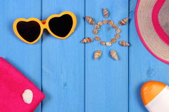 Seashells in shape of sun and accessories for summer and vacation, copy space for text Stock Photo