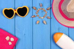 Seashells in shape of sun and accessories for summer and vacation, copy space for text Royalty Free Stock Photos