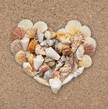 Seashells stacked in the form of heart Royalty Free Stock Photos