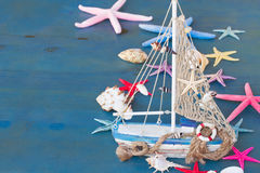 Seashells, starfish and boat with copy space stock photography
