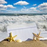 Seashells and starfish with open envelope with blank letter Stock Images