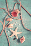 Seashells, starfish and rope on a turquoise background. Postcard Stock Photos