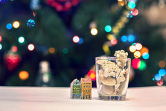 Seashells, stones and colored houses on Christmas Background. For Your Christmas Card Or Poster Royalty Free Stock Photo