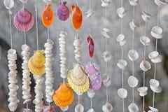 Seashells sulla priorità bassa del filetto fotografia stock