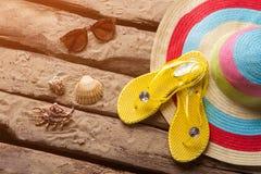 Seashells and yellow flip flops. stock images