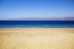 Seashore. Empty beach in a sunny day stock photos