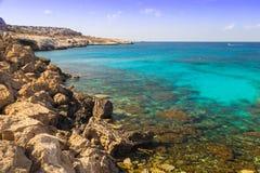 Seashore - azure transparent sea and rocks . Cyprus Stock Photography