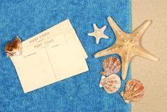 Post card beach towel starfish seashells copy space Stock Photography