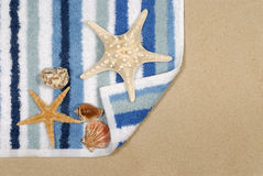 Summer beach scene sand towel starfish copy space Royalty Free Stock Photo