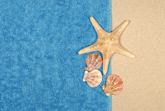 Summer beach background blue towel starfish copy space Royalty Free Stock Images