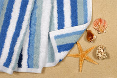 Summer beach vacation scene towel starfish seashells Royalty Free Stock Photo
