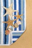 Summer beach scene starfish towel vertical Stock Photography