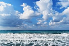 Seashore. With beautiful wavy deep blue sea and cloudy blue sky Stock Images