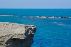 Seashore, big rock, blue water, Caspian sea Stock Photos