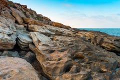 Seashore, big rocks. Seashore, rocks and surf on beach Royalty Free Stock Photo