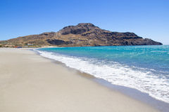 Seashore with blue transparent water on Crete island in Greece Royalty Free Stock Image