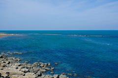 Seashore, blue water, Caspian sea. Seashore, reeves in the sea stock image