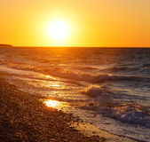 Seashore during bright sundown. Composition of the nature Royalty Free Stock Photos