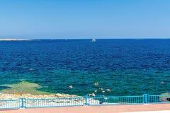 Seashore in Bugibba, Malta. Seashore behind the fence in Bugibba, Malta Royalty Free Stock Photography