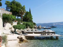 Seashore in Croatia. Beautiful hot summer sunny day in Croatia, with a view to the sea and the holiday resort in Omis Royalty Free Stock Photos