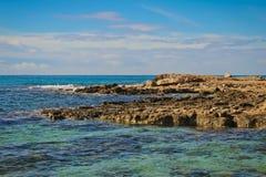 Seashore of Cyprus with rocks. Seashore of Cyprus island with rocky coast in Mediterranean sea Stock Image