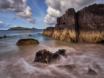 Seashore with dramatic rocks in western Ireland. Wine Strand in Dingle, Western Ireland royalty free stock images