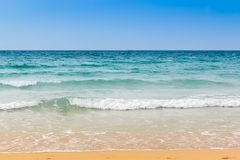 Seashore with flow. Vibrant beach shot with blue sky, turquoise sea flow and yellow sand stock photos