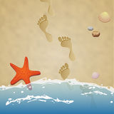 Seashore with footprints in the sand Stock Image