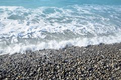 Seashore. With frothy waves and water sparkling clean Royalty Free Stock Images