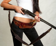 Seashore girl with a gun 1 Royalty Free Stock Image