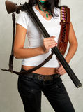 Seashore girl with a gun 4 Stock Images