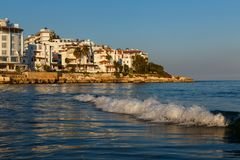 Seashore with hotels and waves. Seashore of Turkey in Mediterranean with white hotel buildings and waves Stock Photography
