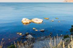 Seashore with large stones. Calm sea. Blue-blue sea royalty free stock photography
