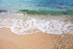 Seashore line with sand beach and sea wave. Turquoise blue tropical sea lagoon for perfect vacation. Royalty Free Stock Photos