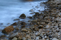 Seashore  in a long exposure shot Stock Photos