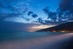 Seashore night view Stock Photos