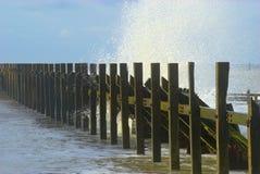 Seashore in Norfolk. Spray on a Norfolk Beach Royalty Free Stock Images