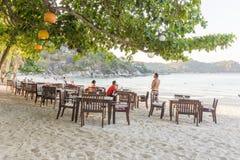Seashore restaurant on a bounty beach. Ao Thong Nai Pan Yai, Koh Pangan, Thailand, April 23, 2016, People enoy the life on a seashore restaurant in the afternoon Stock Images