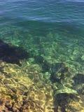 Crystal sea bottom in the sun. stock image