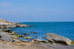Seashore, rocks, blue water, Caspian sea Stock Images