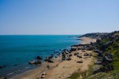 Seashore, rocks, blue water, Caspian sea Stock Photography