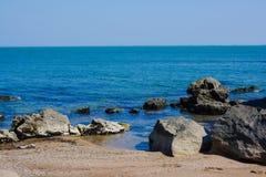 Seashore, rocks, blue water, Caspian sea. Seashore, rocks, blue water stock images