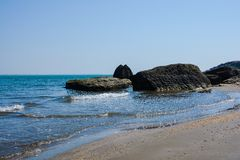 Seashore, rocks, blue water, Caspian sea Royalty Free Stock Photo