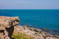 Seashore, rocks, blue water, Caspian sea Stock Image