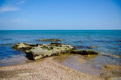 Seashore, rocks, blue water, Caspian sea. Seashore, rocks, blue water stock photos