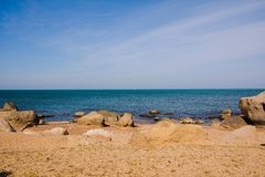 Seashore, rocks, blue water, Caspian sea. Seashore, rocks, blue water royalty free stock photos