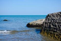 Seashore, rocks, blue water, Caspian sea. Seashore, rocks, blue water stock photography