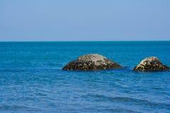 Seashore, rocks, blue water, Caspian sea. Seashore, rocks, blue water stock image