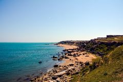 Seashore, rocks, blue water, Caspian sea royalty free stock photos